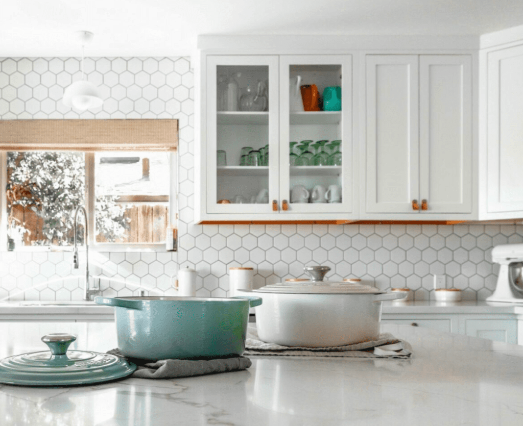 bright kitchen with crockery and mixer on counters