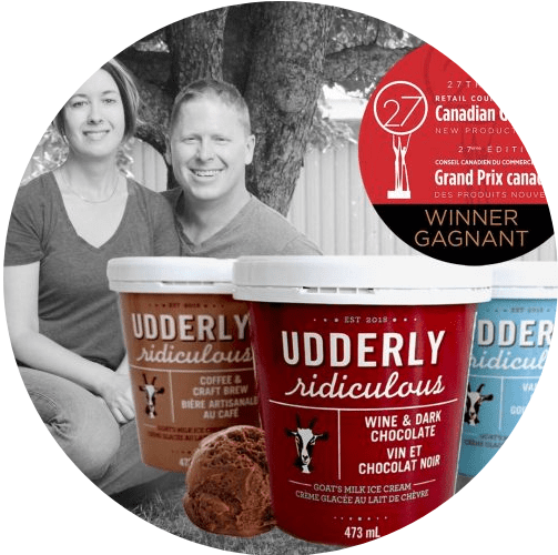 Udderly Ridiculous owners posed behind cartons of their goat icecream