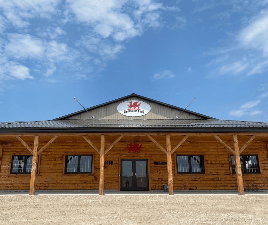 front façade of red dragon dairy building against bright blue sky