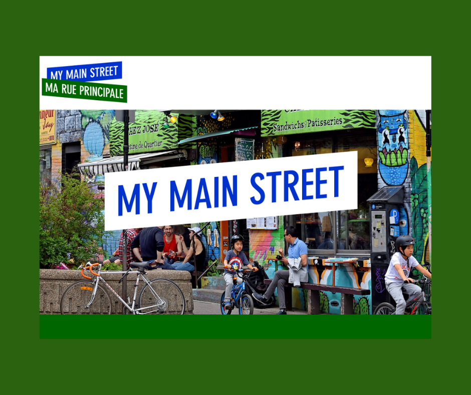 """My Main Street"""" superimposed across colourful downtown streetscape"""