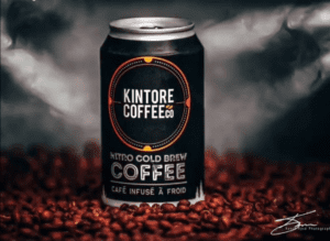 Can of Kintore Coffee Cold Brew on coffee beans