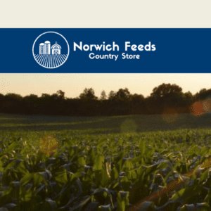 Norwich Feeds Country Store logo in blue and white superimposed on farm field at sunset